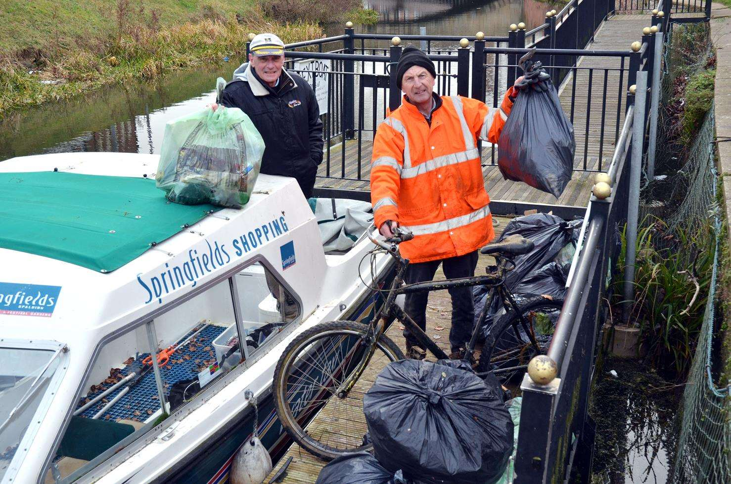 Anthony Grunwell and Ian Haynes with a bike and 18 bags of rubbish - a further ten bags were left out for council collection at a spot near the old fire station. (290119-14)