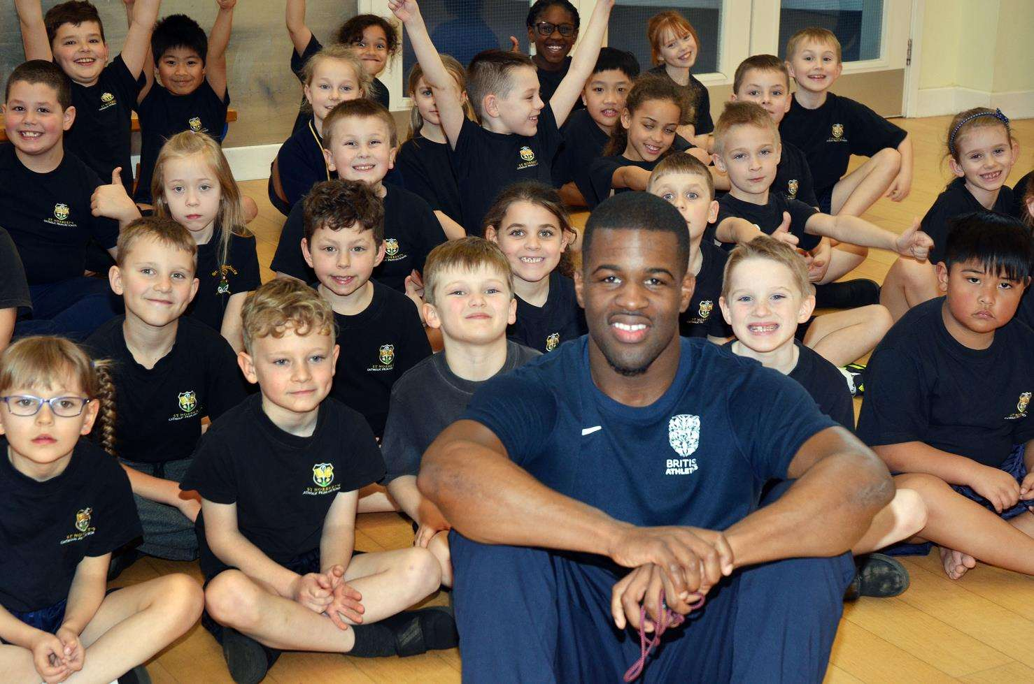Double Commonwealth gold medallist sprinter Leon Baptiste leads a fitness session with Year 2 and 3 pupils at St Norbert's Catholic Primary School, Spalding. Photo by Tim Wilson. SG-050319-027TW