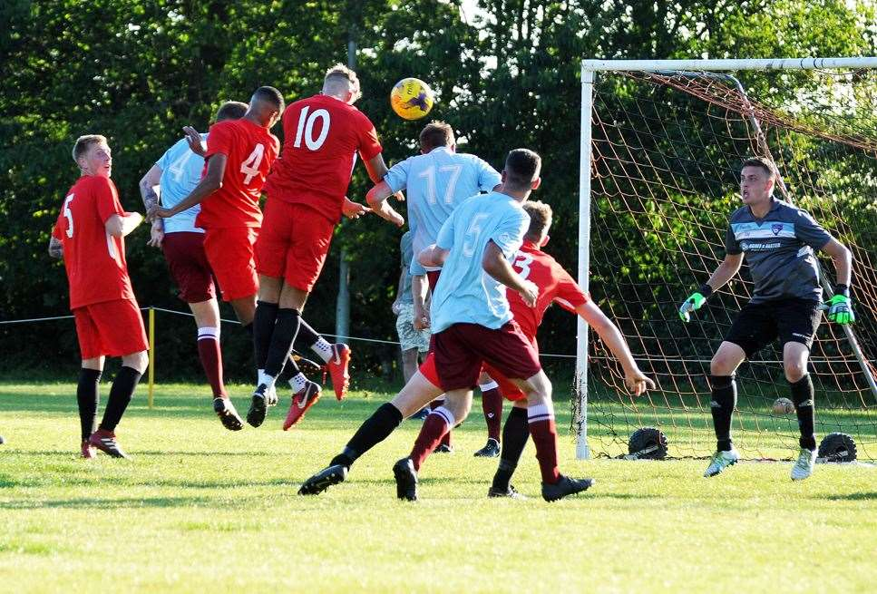Jordan Nuttell gets in a header against Bourne. (13690339)