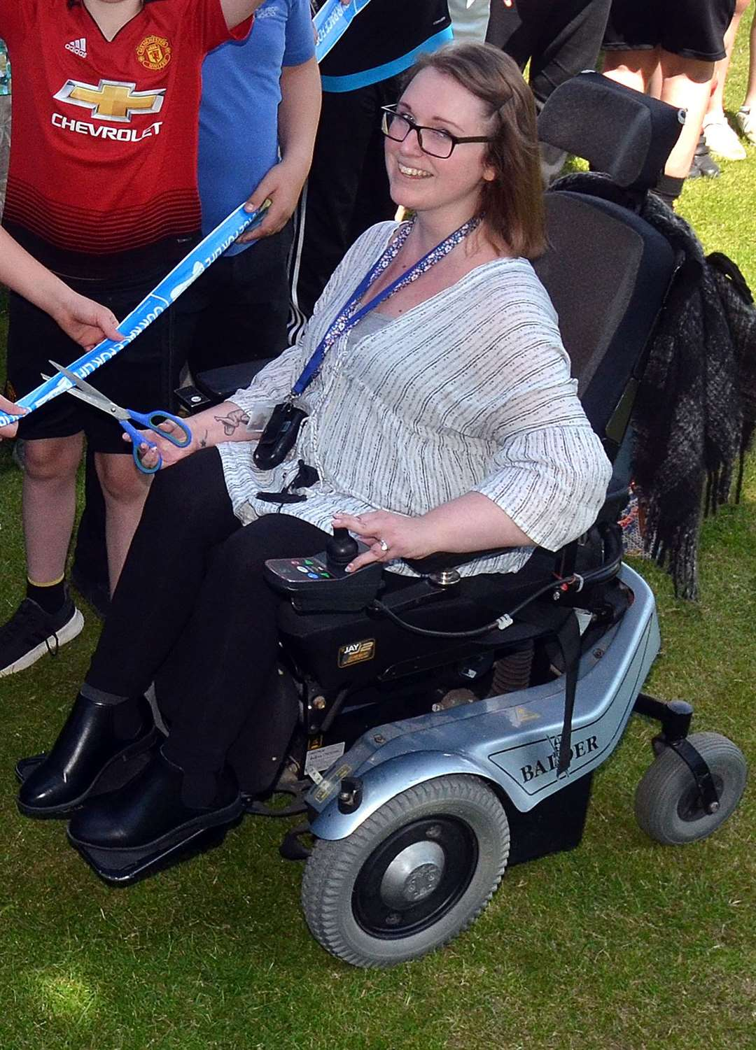 Nicole Amott, pictured at The Priory School cutting the tape at the start of The Race for Life this May, shortly before her accident