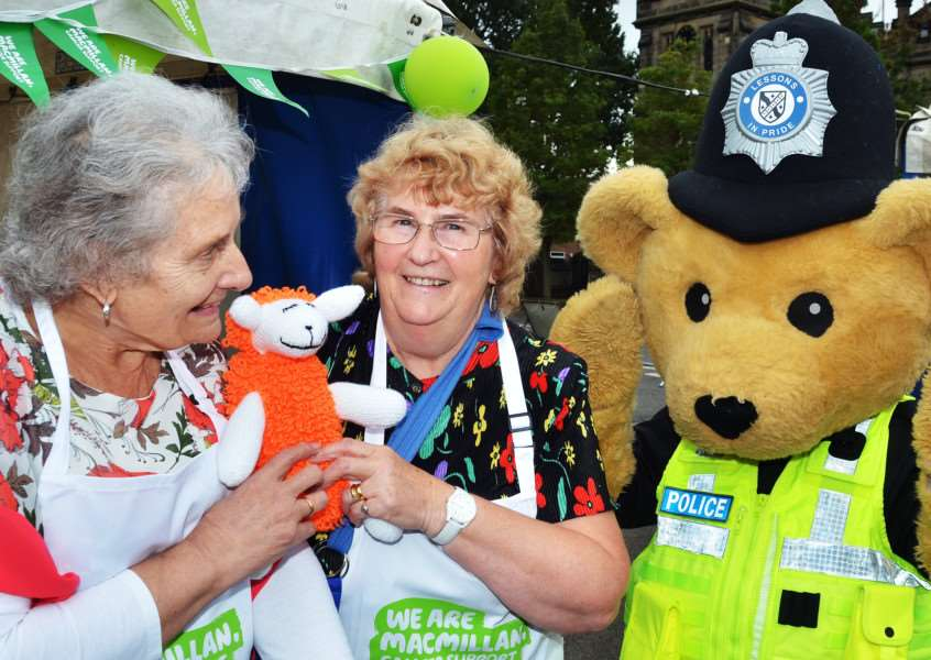 CHARITY STALWART: Vera Angelo (centre) with Liz Breach and Bobby Bear in Sheep Market during the annual Spalding Pumpkin Festival in October. Photo by Tim Wilson. ''SG131017-146TW.