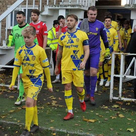 Captain Lewis Brownhill, leading Spalding United out against Stamford, is one of three players to have left the Tulips.Photo by Tim Wilson.SG-211219-226TW.