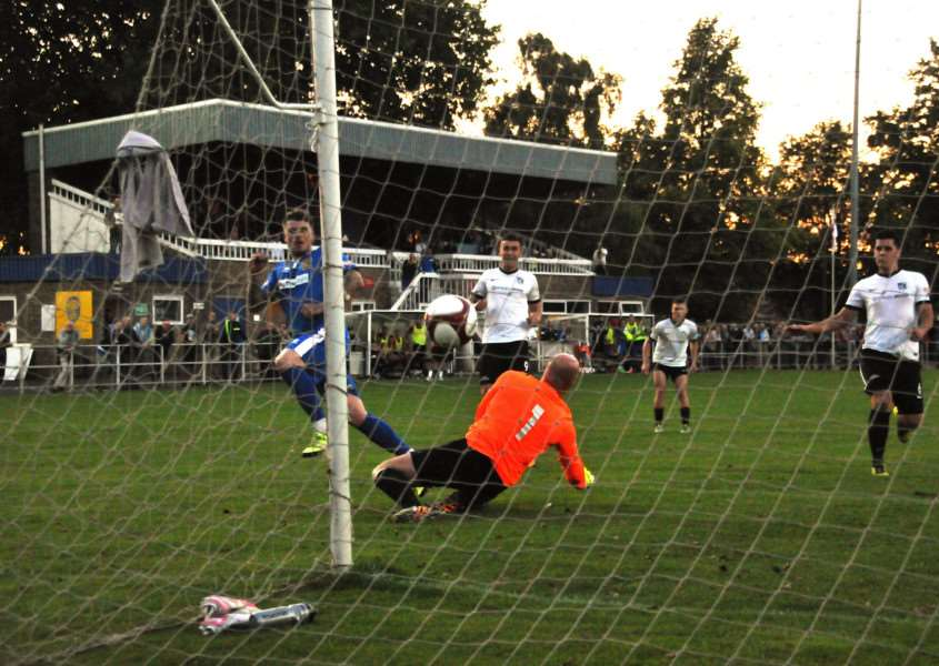 Gary King tucked the rebound past keeper Paul Bastock following his penalty save as Spalding beat Corby at the Sir Halley Stewart Field in mid-August.