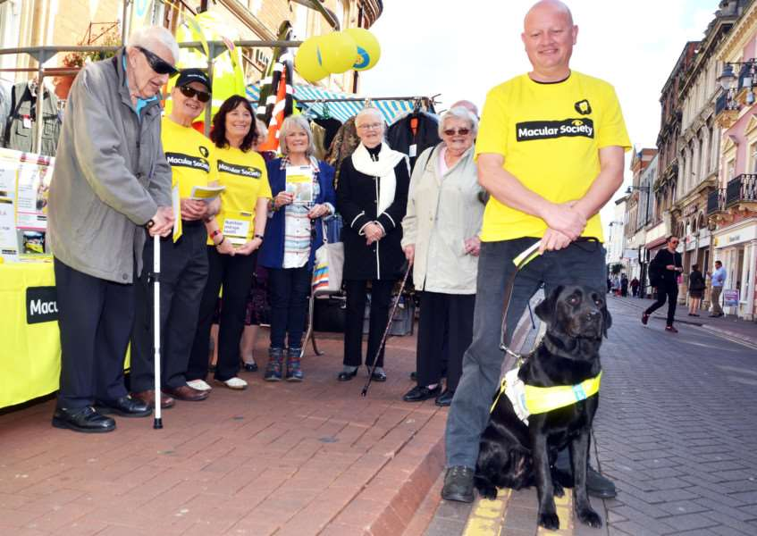 Macular Society regional manager Colin Daniels (right) with guide dog Woodie and members of the Spalding branch. SG190917-156TW