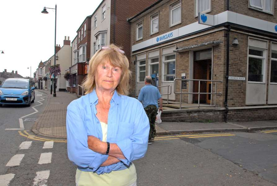 Joan Woolard outside Barclays Bank, Holbeach , during her protest in 2013