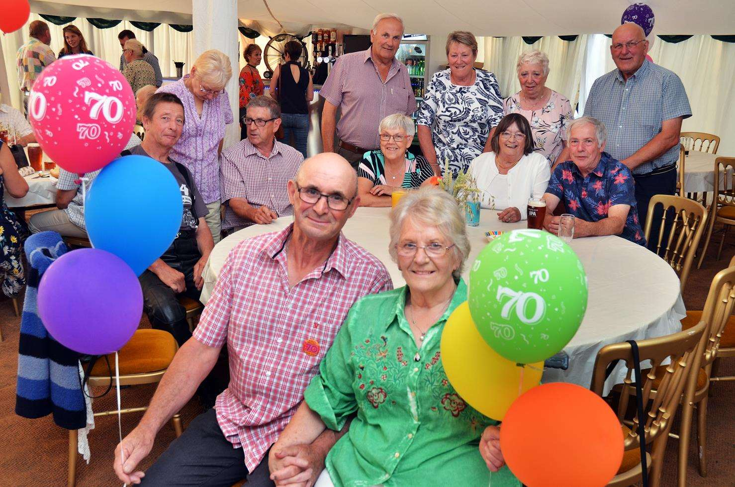 BIRTHDAY COUPLE: Eric and Marilyn Collishaw, with family, friends and neighbours, have a 70th birthday hog roast party for Lincs & Notts Air Ambulance at their home in Gedney Hill. Photo by Tim Wilson. 070718187SG.