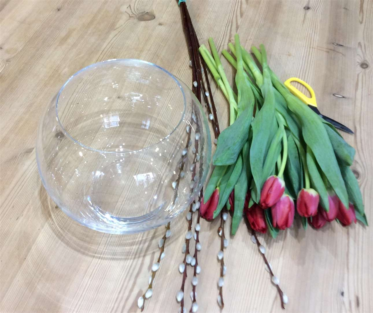 To get started, you will need a clear glass bowl, some tulips, some willow and a drop of water. (6926553)