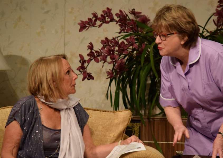 ST NICOLAS PLAYERS: Phyllis Sullivan (Bev Moore) and waitress Marcia Jones (Linda Smith) in St Nicolas Players' production of Old Actors Never Die...They Simply Lose the Plot at South Holland Centre, Spalding. Photo by Colette Buchanan-Gray.