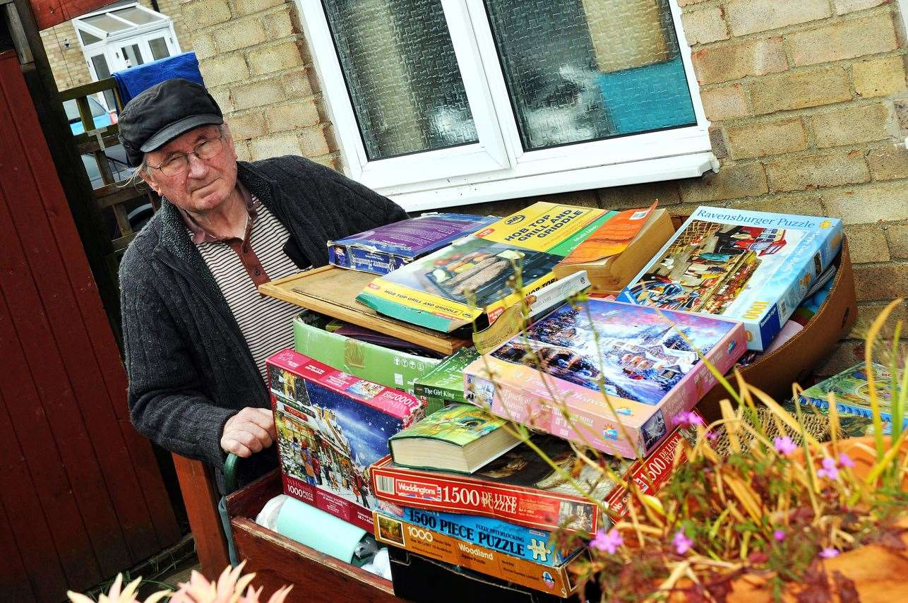 Les Ward with his rain damaged bric-a-brac, after a cover was pulled off his cart by an intruder. (9394101)
