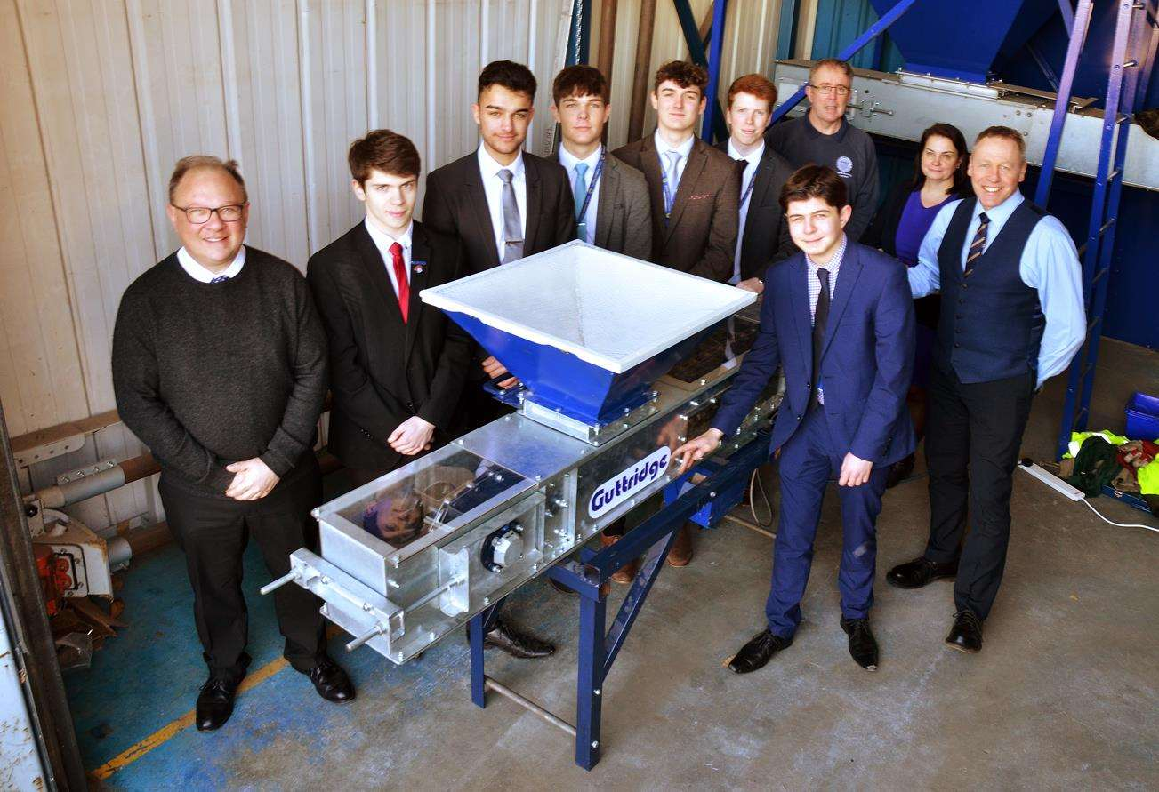 Mechatronic students deliver their chain conveyor to Guttridge Engineering - pictured right is, Neil Storer, from the firm, with student Adam Mountain to his left. SG-110219-207TW