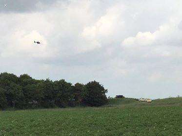 Police helicopter flying over the scene at Moulton Marsh. Photo: Becky Ette.