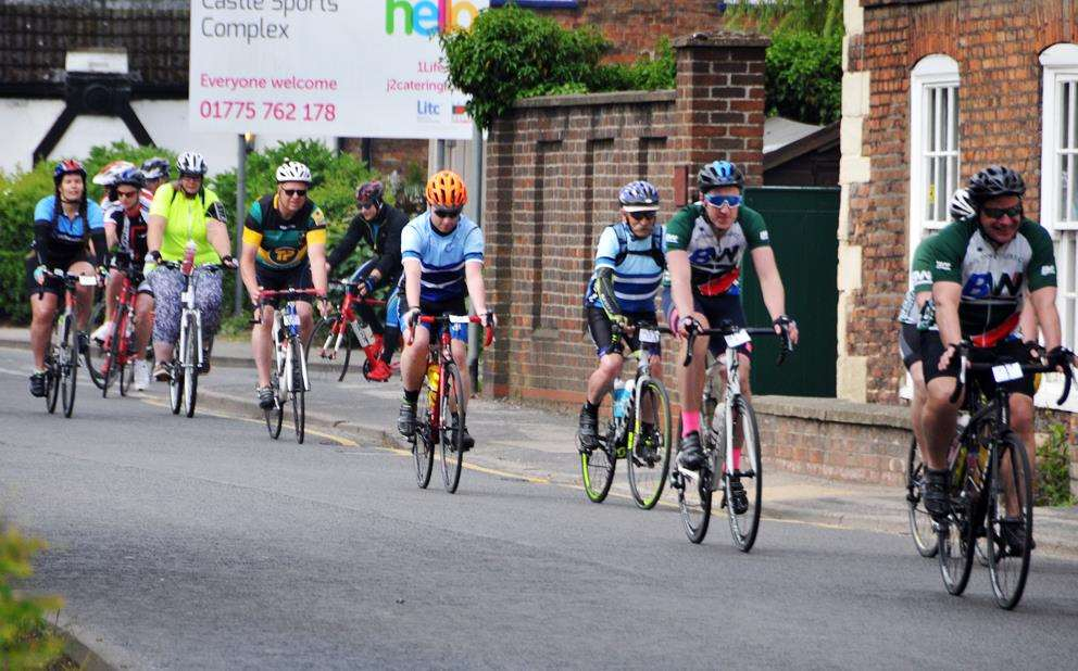 Some of the 25 riders leaving Castle Sports Complex, Spalding, on their way to the Princess Royal Sports Centre, Boston, and then Peele Leisure Centre, Long Sutton. Photo by Tim Wilson.