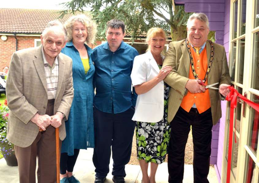The opening of The Hive coffee shop at Capricorn Cottage, Fleet Hargate, with resident Tony Ralph, manager Christine Jones, resident David Oliver, Christine Grocock and Coun Rodney Grocock, chairman of South Holland District Council. Photo by Tim Wilson. SG110817-133TW.