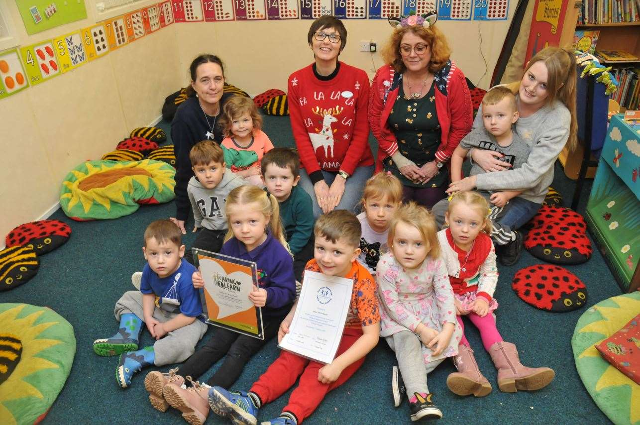 Manager Kathy Crouch (back row second right) with staff members Judith Sumner, Jane Harriss and Shelby Sparks, alongside children at Abbey 345 Pre-School in Crowland.Photo by Tim Wilson.SG-121219-021TW.