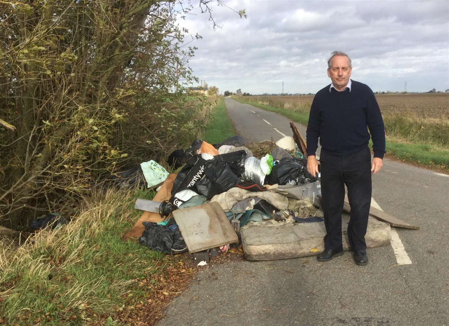 'TERRIBLE' FLYTIPPING: Coun Anthony Casson comes across household waste dumped on Delgate Bank, Weston Hills. Photo supplied.