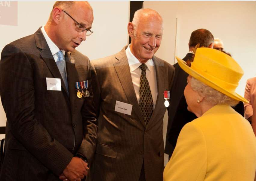 Coun Graham Dark (second left) and his son, retired Detective Superintendent Stuart Dark, meet the Queen at the official opening of the Metropolitan Police's new headquarters in London. Photo supplied.