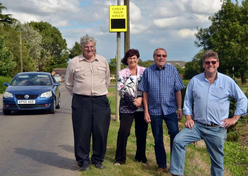 Parish councillors Henry Neale, Jennifer Garbutt, Chris Griggs and Bill Harrison with one of the speed recording devices. SG240617-236TW