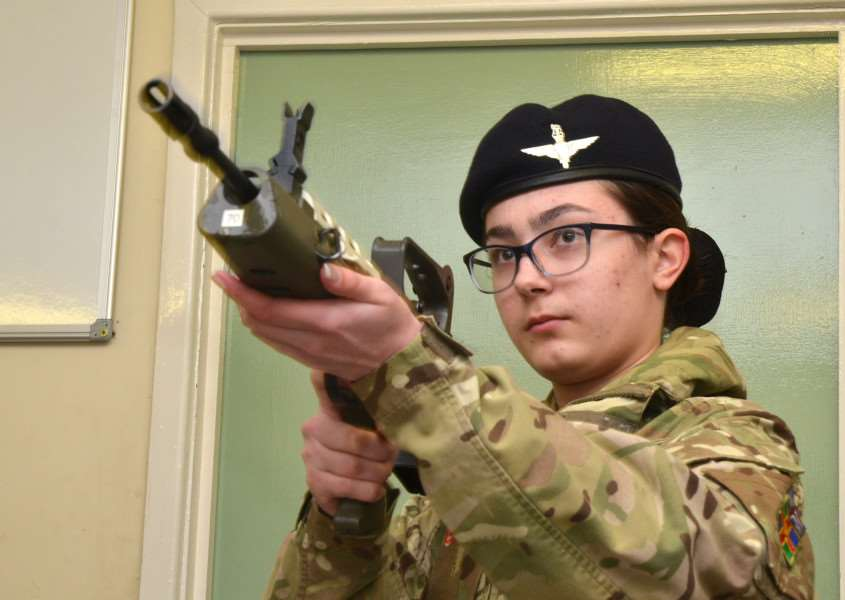 Cadet Billie-Jo learns to handle a rifle safely. (SG150218-109TW).