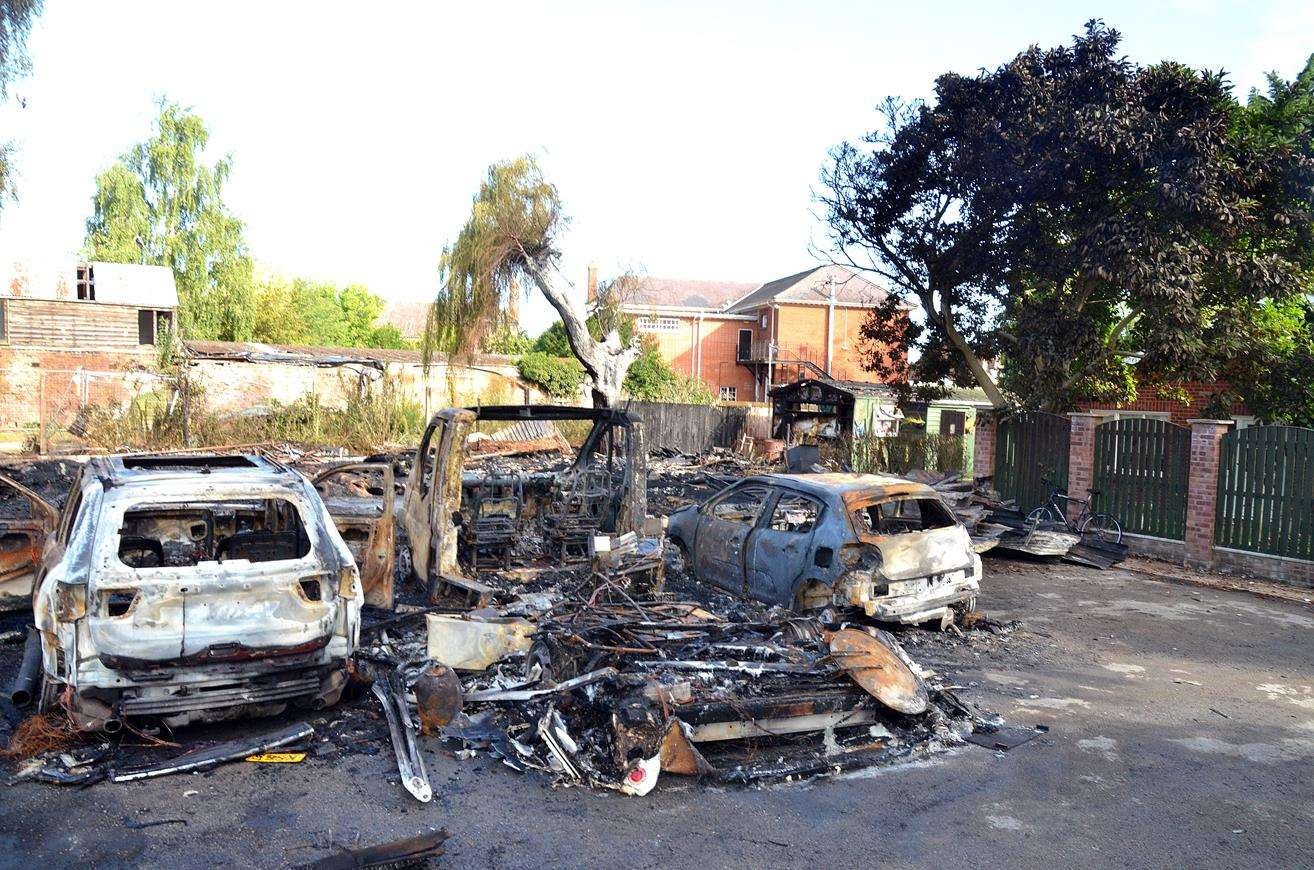 The cars and camper van destroyed by a fire outside Robert Green's home in Long Sutton. Photo by Tim Wilson. 010818104SG