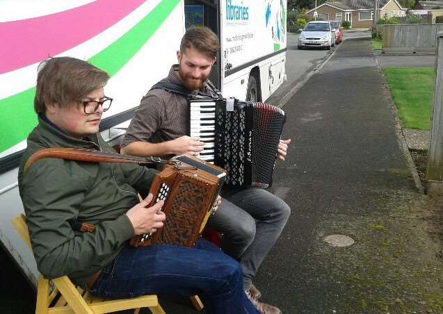 Danny Pedler and Dave Gray entertain people outside the mobile library as part of Transported's Field and Dyke Project.