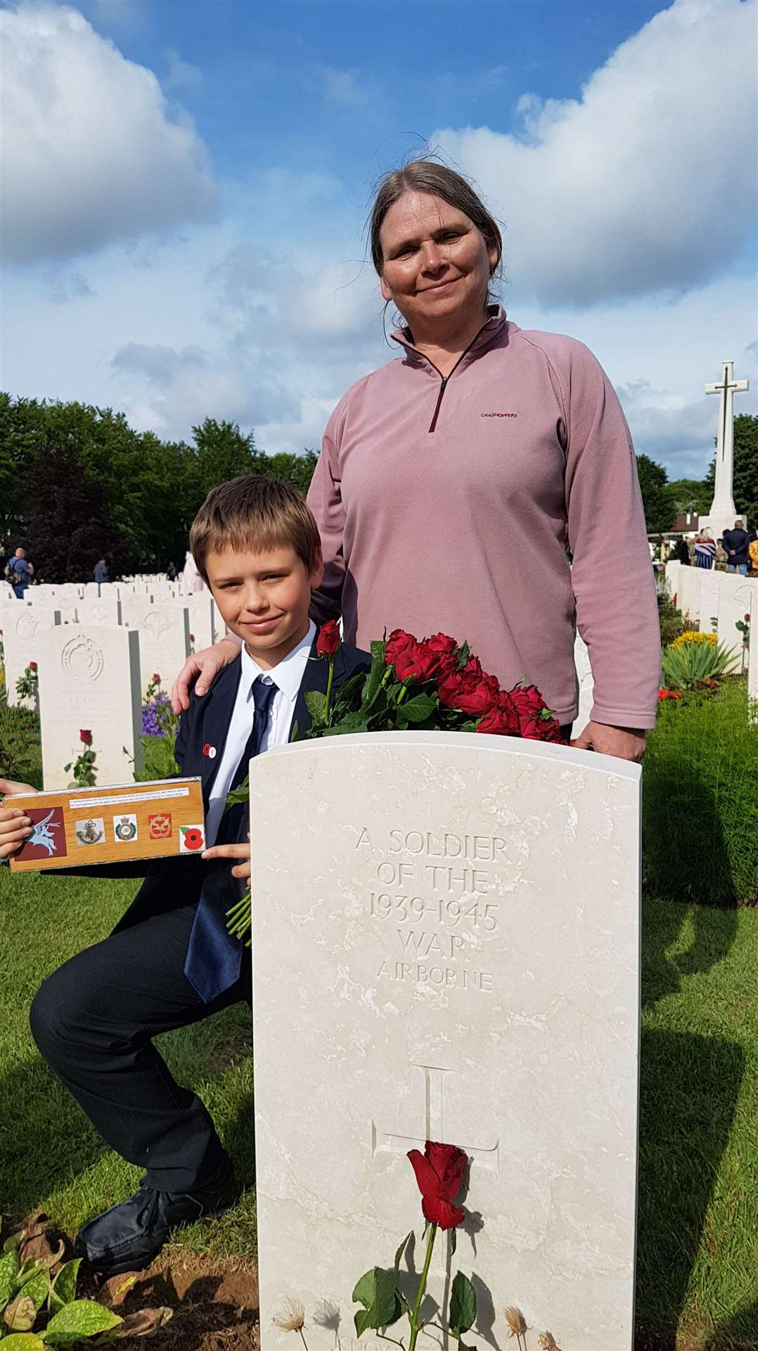 Archie Morant (13) and mum Alison at Ranville Cemetery.(11906574)