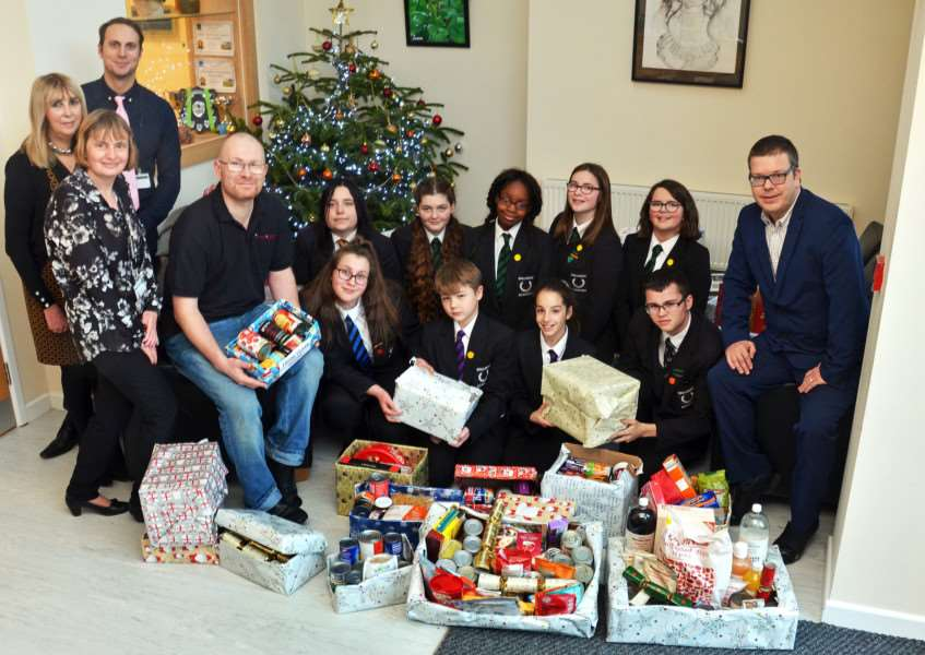 HELPFUL HAMPERS: Students from Spalding Academy present their Christmas Foodbank hampers to Darren Fawcett, assistant co-ordinator of Agapecare Foodbank Spalding (left) and Jeremy Ransome (right), editor of the Lincolnshire Free Press and Spalding Guardian. Photo by Tim Wilson. SG151217-101TW.