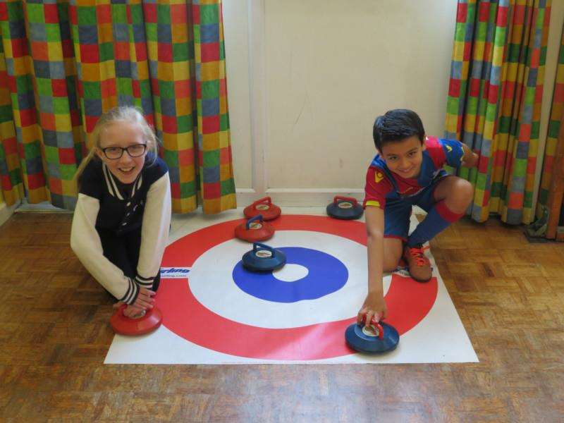 Youngsters have a go at curling.