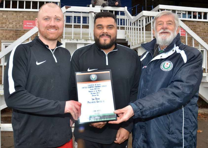 Ian Dunn and assistant Allan Ross collected the December manager-of-the-month award from league chairman John Weeks