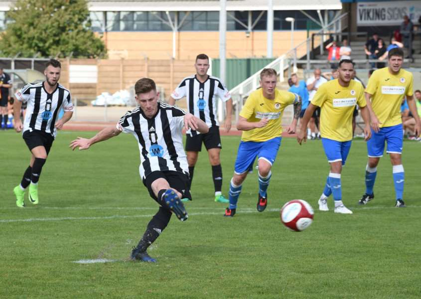Andrew Wright, who started last season on loan at Spalding United, fires Grantham's winner in first-half stoppage-time against Holbeach on Saturday. Photo by Toby Roberts