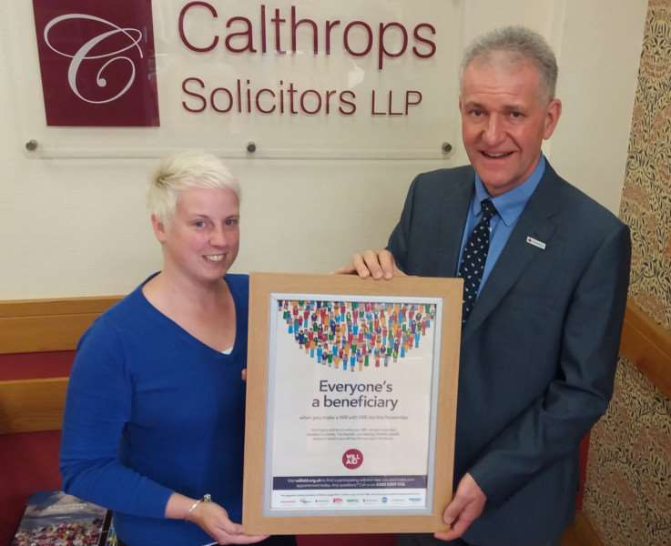 Laura Brown, of Calthrops Solicitors in Spalding with John Coulthurst of the British Red Cross, promoting Will Aid 2017.