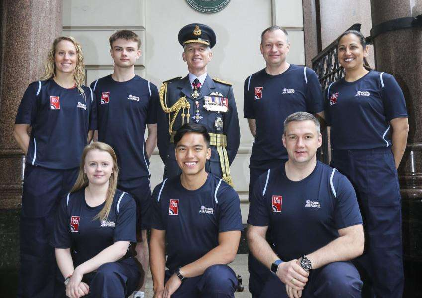 RAF AT 100: Flight Lieutenant Lucy Nell (back left) with other RAF100 Baton Relay runners and the Chief of the Air Staff, Air Chief Marshal Sir Stephen Hillier, at the Royal Courts of Justice in London before the start of the Relay. Photo by Sergeant Peter George.