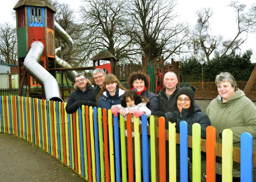 Gaynor Fiske (fourth from left) and volunteers spent eight Sundays re-painting the fence for the children's play area at Glen Park in Surfleet. (SG100218-108TW)