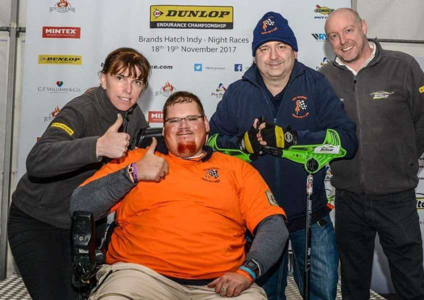Pictured (from left) are Claire Hedley, the Britcar organiser and co-owner, CRPS fundraisers Charles Carter and James Wilson-White, and Rob Hedley, Britcar co-owner.