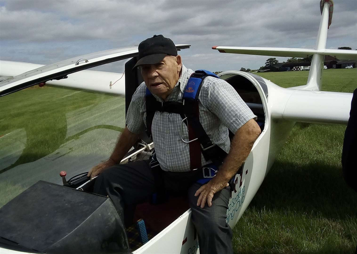 Nev climbing out of the glider after an enjoyable flight to celebrate his 90th birthday