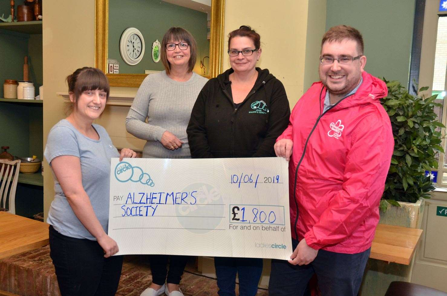 Spalding and District Ladies' Circle members (from left) Amy Darlow, Ann Darlow and Louise Luck present £1,800 to Alzheimers Society community fundraiser for East Midlands Olly Larkin.