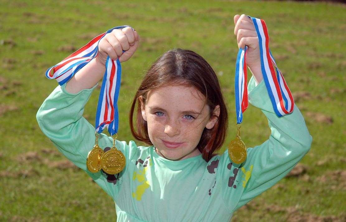 Leah Barker with her medals that she took into school for a special assembly.