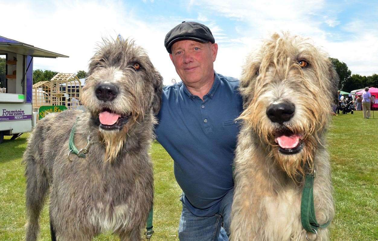 Irish wolfhounds Betty and Arthur with owner Andrew Fox at the Crowland Show in 2018.Photo by Tim Wilson.230618135SG. (2731231)