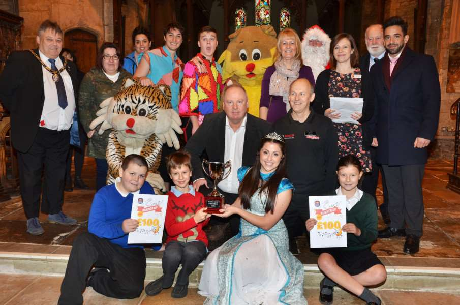 TOP THREE: Judges and sponsors line up with recipients from the top three schools, Samuel of St Pauls, Anthony of St John's, Panto princess Amy Forder and Isabella of Linchfield Deeping St James.