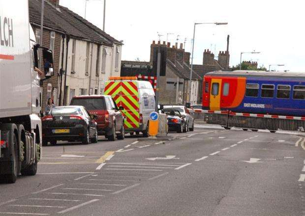 Vehicles queuing at Winsover Road level crossing in Spalding. Photo by Tim Wilson. SG020614-203TW.
