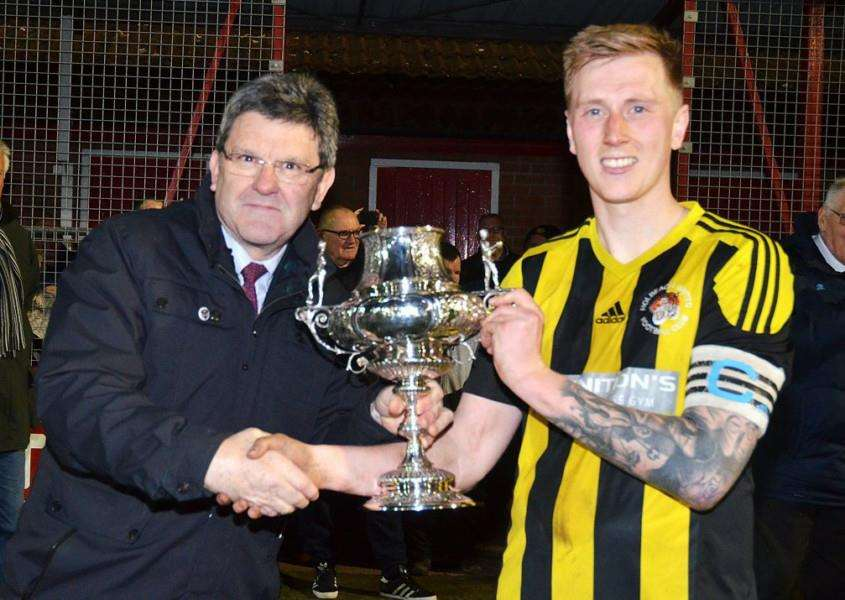 Captain Nick Jackson collects the Lincolnshire FA Senior Trophy