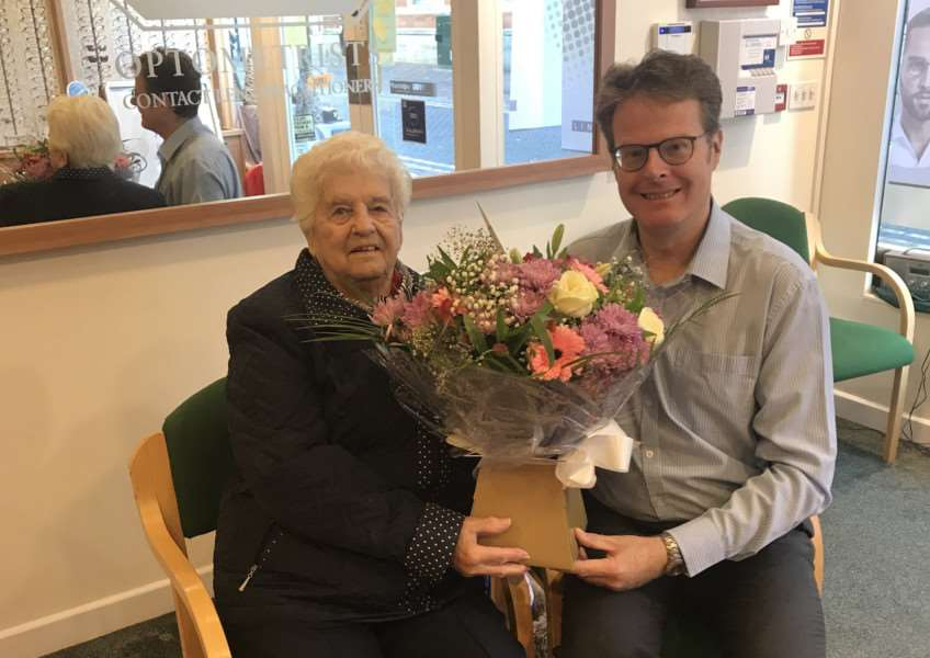 Andy Molsom presents his longest standing patient, 93 year old Mrs Doris Rolfe, with flowers to celebrate 20 years of Molsom & Associates.