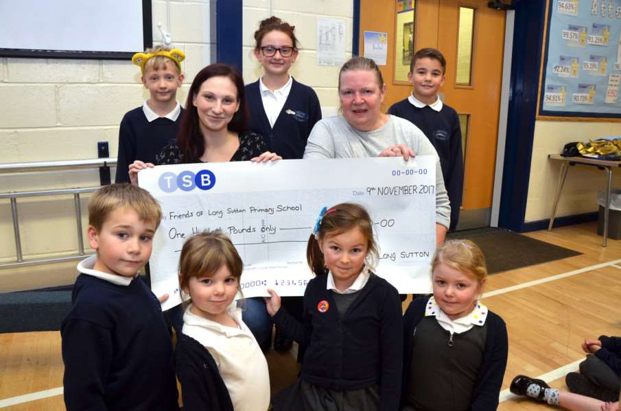 The school celebrates as TSB donate �100 to the Friends. SG171117-137TW
