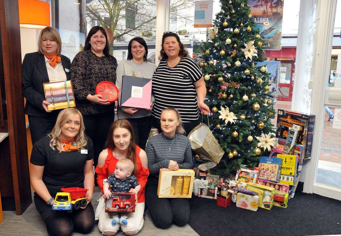 Pictured (from left) are: back - Co-op Travel manager Kate Foreman, Lime House manager Jane Dhanji, Lime House support worker Louise Sandhu, charity fundraiser Mandy Baxter; front - Rox Murfitt, from Co-op Travel, Rosie Aston with baby James Gallagher and Diana Austin