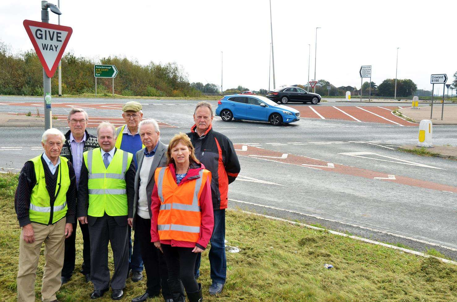 Crowland parish and district councillor Bryan Alcock and county councillor Nigel Pepper (front left and second left) at the A16/B1166 junction in Crowland with parish councillor David Ringham, district councillor Angela Harrison, (back) parish councillors Philip Green and Michael Atkinson, along with David Barfoot.Photo by Tim Wilson.SG-171018-003TW