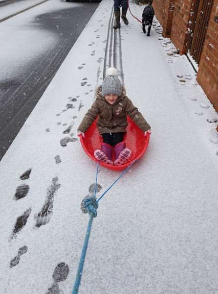 Sarah (4) enjoyed sledging on the river bank in Spalding. Photo: Maria Newell