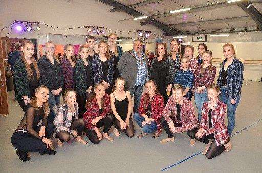 South Holland District Council chairman Coun Rodney Grocock with Claire Patman and students from Spalding School of Dance at the opening of the new CB Dance Studios. Photo by Tim Wilson. SG280418-179TW. (2042160)