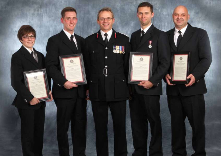 'HEROIC ACTIONS': Members of the Spalding fire crew receive their commendations from Chief Fire Officer Nick Borrill (centre).Photo supplied by Lincolnshire County Council.