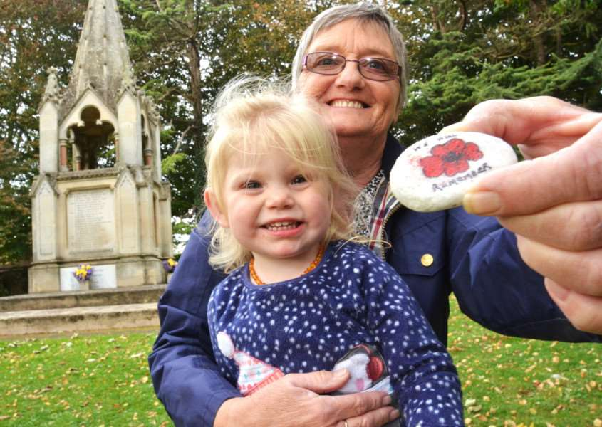 Karen Tidwell with her granddaughter Lani Tidwell holding one of the remembrance rocks that have been placed at st mary's church in pinchbeck. they are not believed to be among the rocks that have gone missing. SG171017-215TW