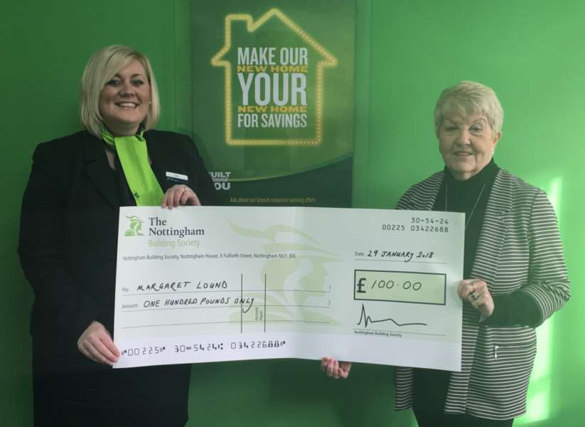 Happy Margaret Lound (right) popped into The Nottingham's Spalding branch to receive her prize from customer services consultant Kelly Cross.