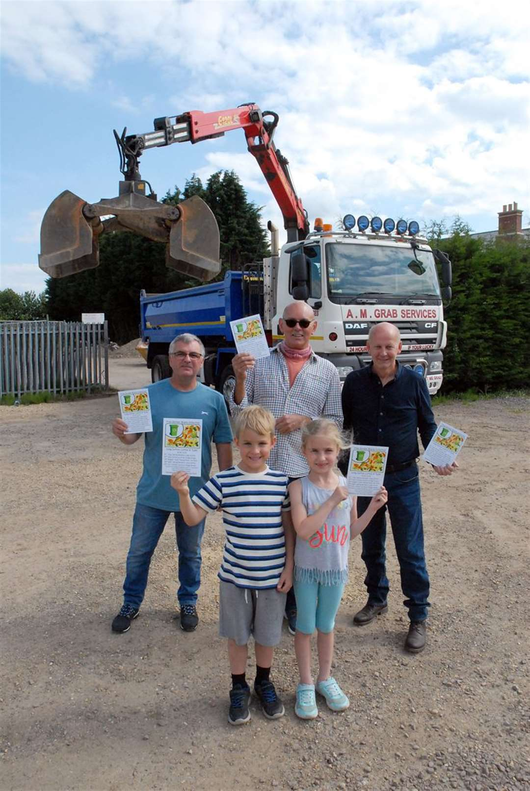 Andy McGee (left), of A M Grab Services, with councillors David Wilkinson and Jack Tyrrell, and (front) Max and Lucy Wilkinson.